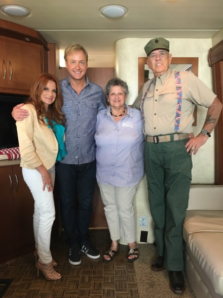 Tracy Christman, co-host Art Edmonds, Pam Shaw, Budget Blinds franchise owner, and Gunny on the set of Military Makeover