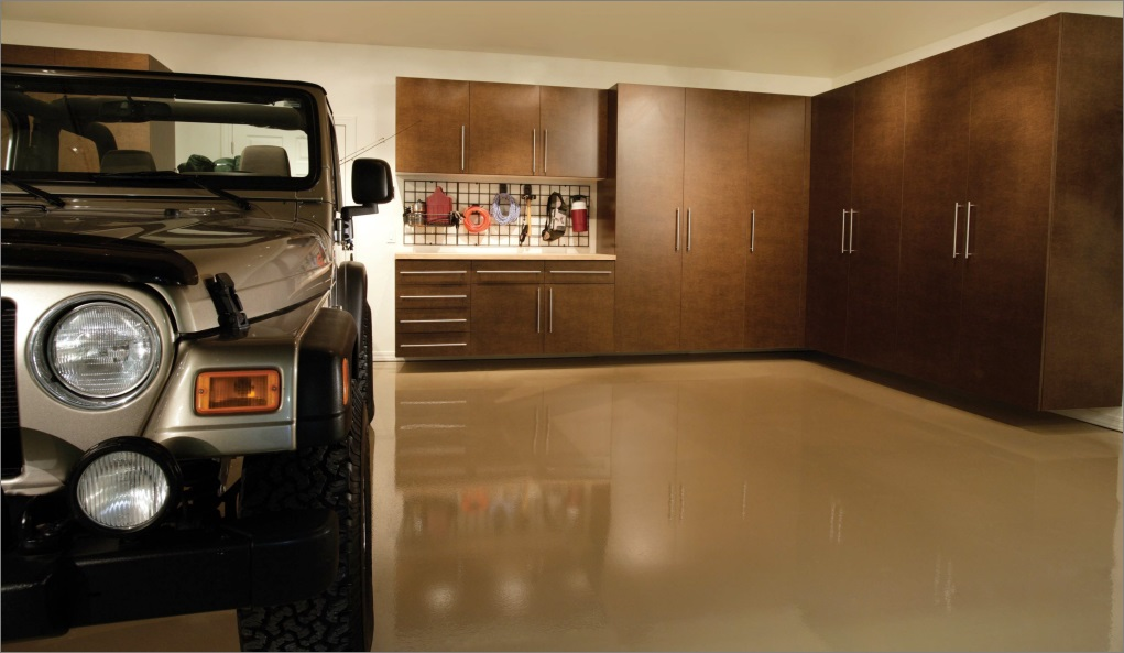 Custom garage design, including garage storage cabinets and custom flooring, are a big part of a Tailored Living franchise business
