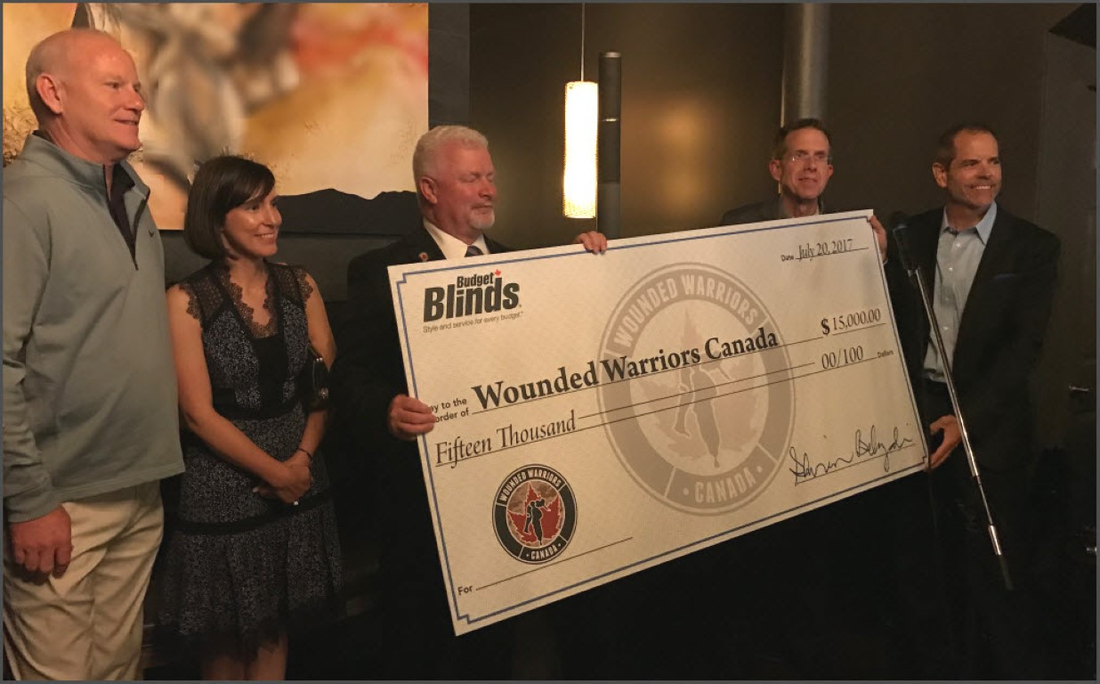 check presentation to Wounded Warriors Canada