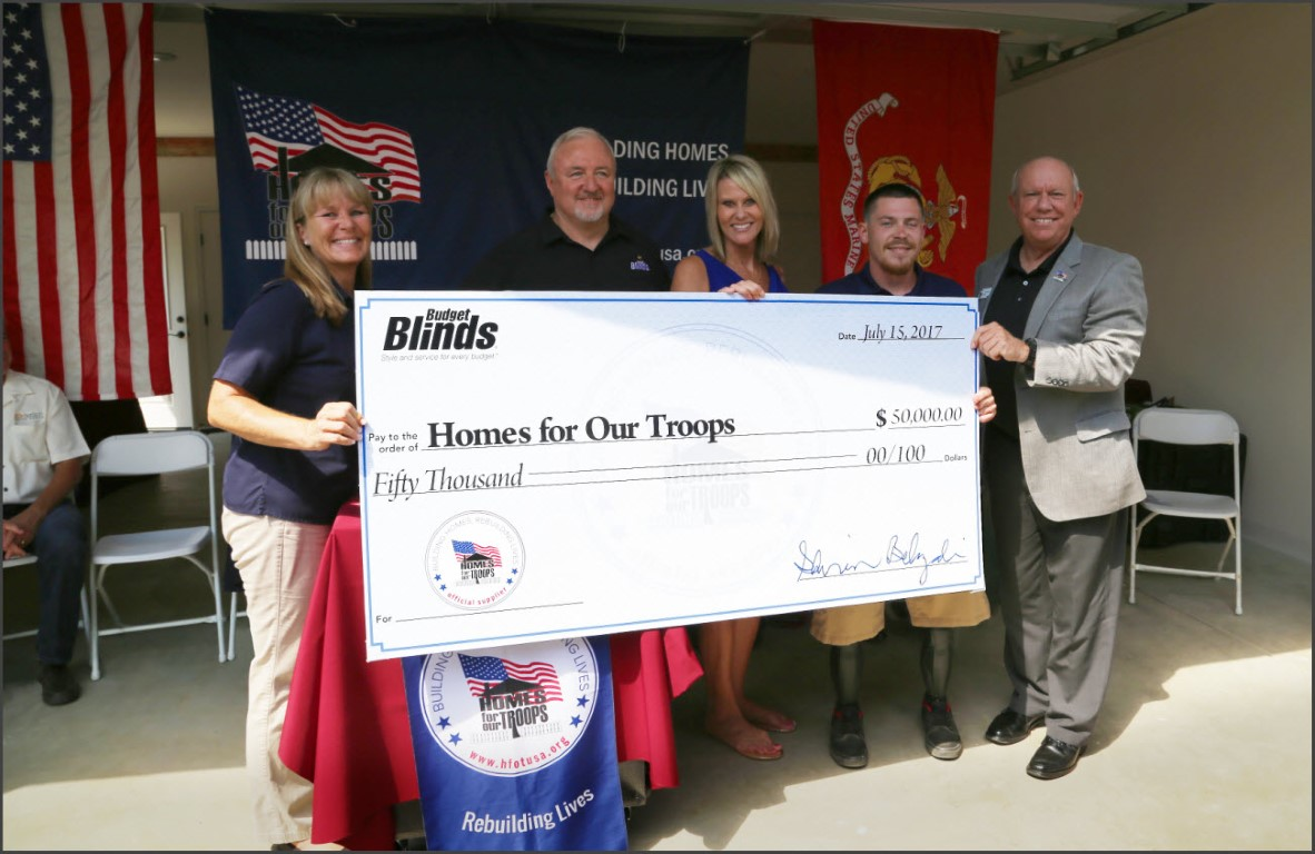 Check Presentation to Homes for Our Troops